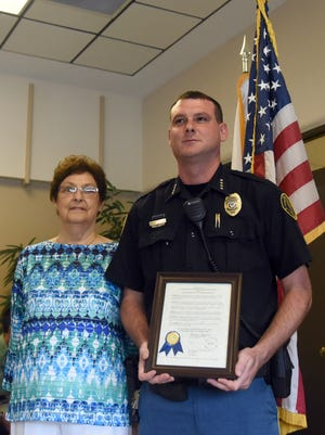 Former Sumrall Mayor Gerolene Rayborn stands with former Sumrall police chief Chris Dungan during the 2016 Sumrall Police Officers Appreciation Luncheon at Town Hall.