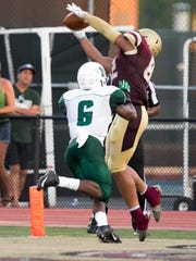 Kellen Williams, right, stretches to come down with a catch for Kutztown University this season.