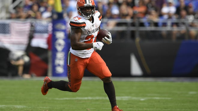 Cleveland Browns running back Nick Chubb (24) runs with the ball during the first half of an NFL football game against the Baltimore Ravens, Sunday, Sept. 29, 2019, in Baltimore.