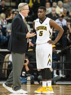 Fran McCaffery discusses things with Anthony Clemmons, one of two senior point guards on the 2015-16 Hawkeyes. That is the biggest position of need heading into next season.