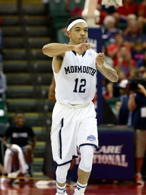 Monmouth Hawks guard Justin Robinson (12) reacts after making a layup against the Notre Dame Fighting Irish during the second half at ESPN Wide World of Sports Complex.