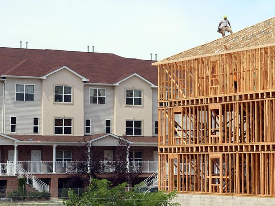 Construction continues on new units on the east side of the West Gate development in Lakewood in August 2015.