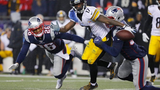 New England Patriots linebacker Kyle Van Noy, right, pops the ball loose from Pittsburgh Steelers receiver Eli Rogers during the AFC championship game last Sunday.