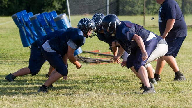 The Yale High School Bulldogs run drills during practice on Aug. 15. The Bulldogs' first game will be against North Branch on Aug. 24.