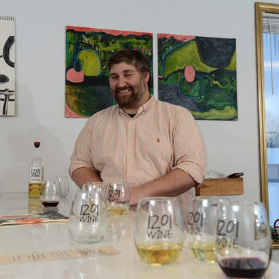 Andy Rahe laughs as he talks about his winery 1201