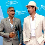 George Clooney, left, and Brad Pitt pose during the photo call of their movie 'Burn After Reading' at the 65th edition of the Venice Film Festival in Venice, Italy, on Aug. 27, 2008.