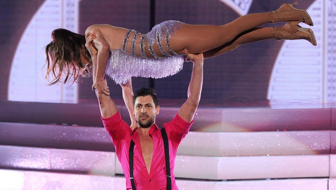 Jennifer Lopez is thrown in the air by Maksim Chmerkovskiy during the 2013 American Music Awards at Nokia Theatre L.A. Live on November 24, 2013 in Los Angeles, California.