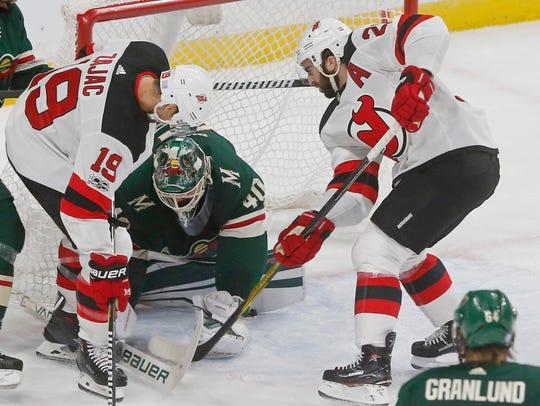 Minnesota Wild goalie Devan Dubnyk, center, defends