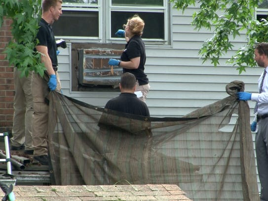 Monmouth County investigators are shown behind the