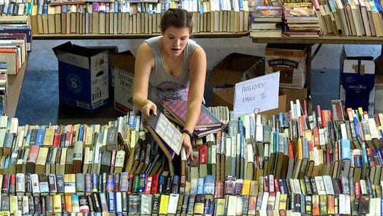 Volunteer Allyson Altland, 15, of Spring Grove, sorts books while helping organize York County Heritage Trust's Book Blast 2015 at the Agricultural & Industrial Museum. The used book sale at the museum features thousands of book in most genres. The event runs through Saturday.