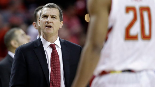 Maryland head coach Mark Turgeon speaks with Maryland guard Richaud Pack (20) during a timeout in the second half of an NCAA college basketball game against Michigan State, Saturday, Jan. 17, 2015, in College Park, Md. (AP Photo/Patrick Semansky)