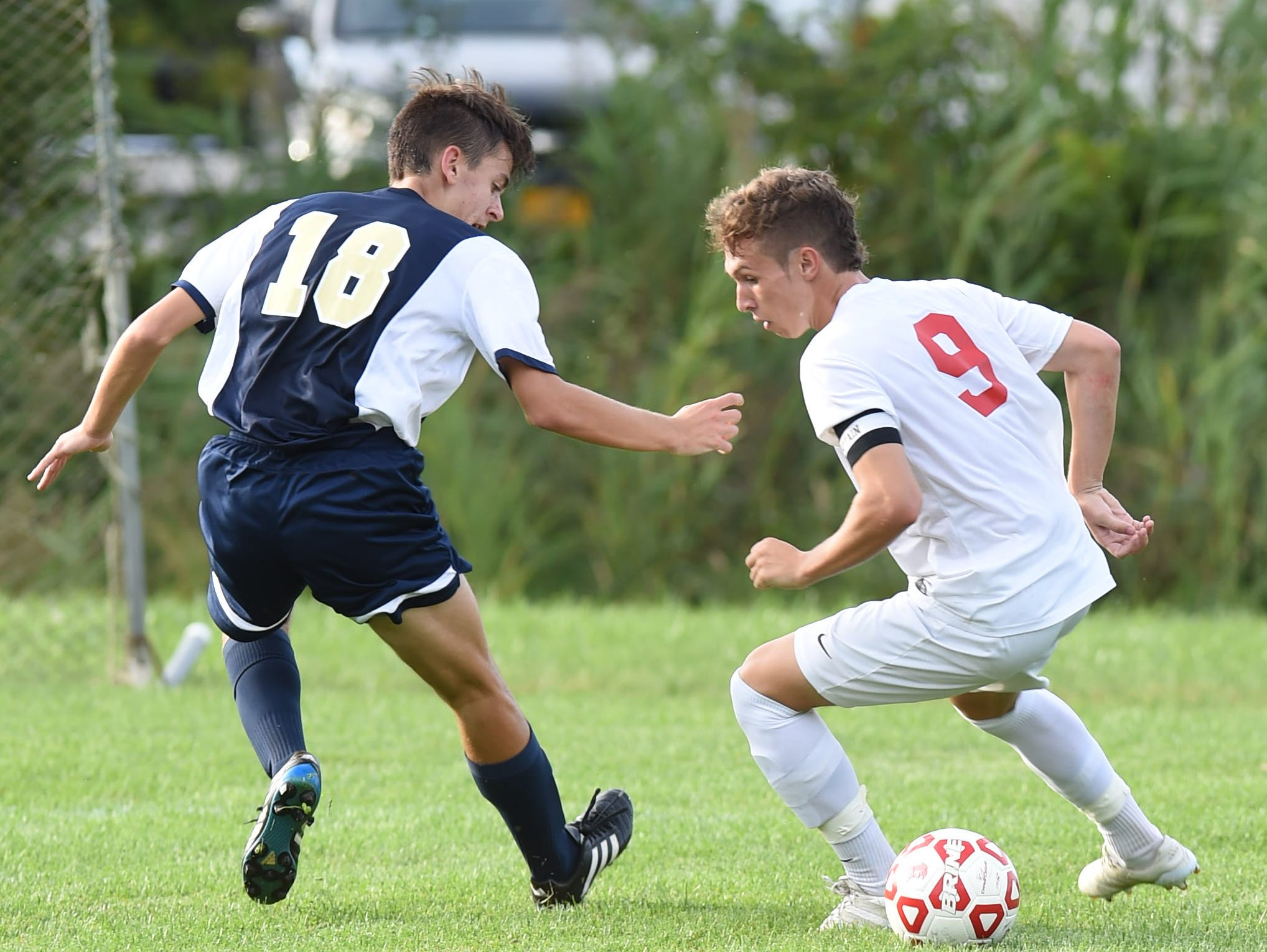 From left, Beacon's Noah Mensch covers Roy C. Ketcham's Nick Botscheller during Tuesday's game at Ketcham.