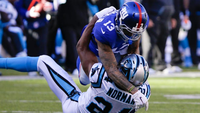 Giants WR Odell Beckham (13) and Panthers CB Josh Norman square off last December.