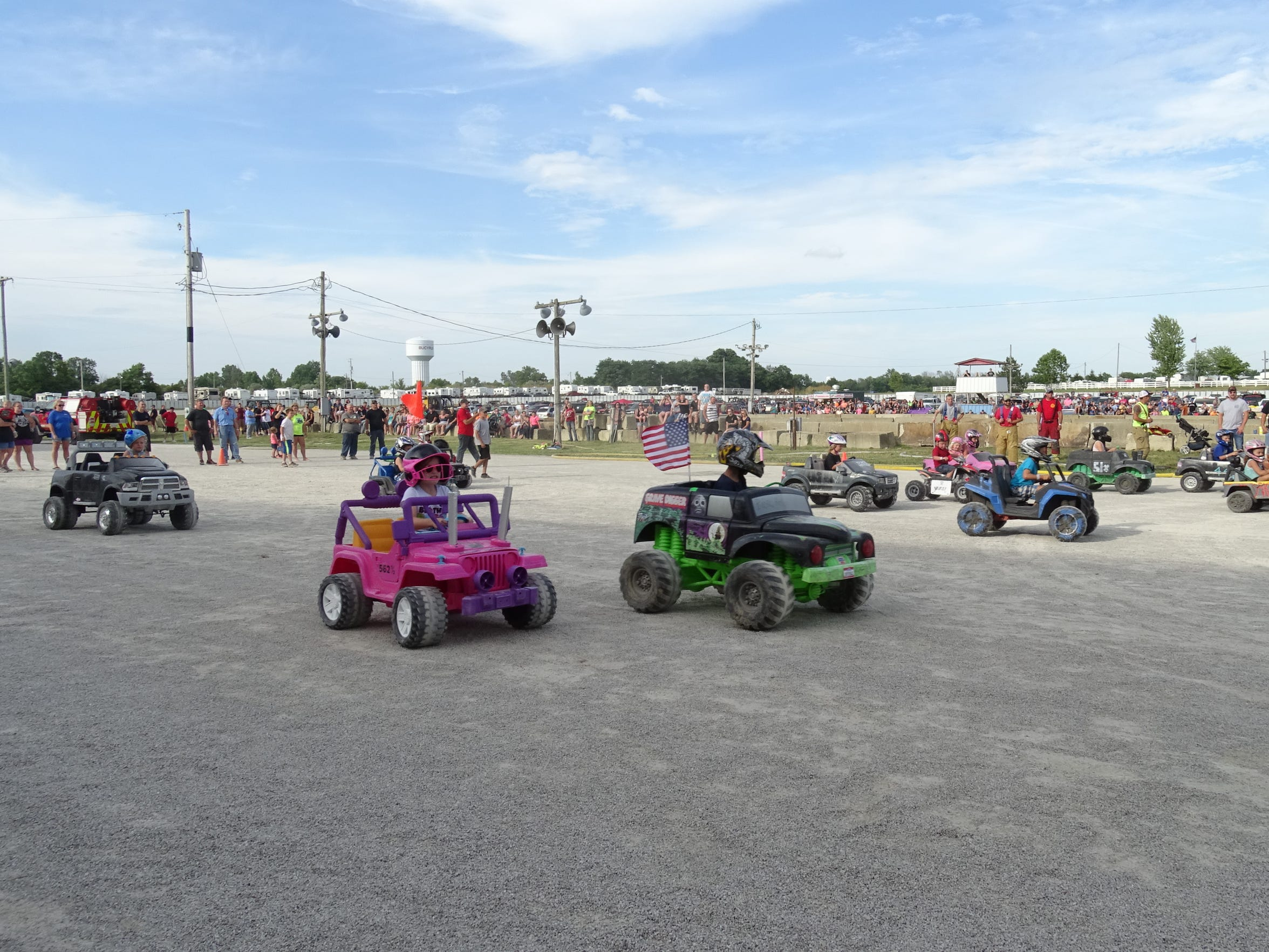 Nearly two dozen youngsters race their electric cars Sunday before the demolition derby at the Crawford County Fair.