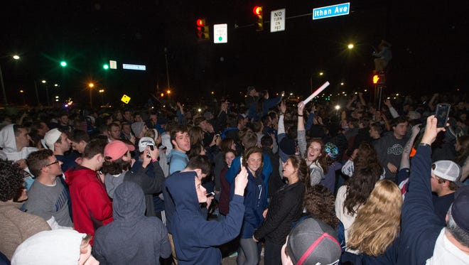 Villanova fans celebrate in the street after a watch party at the Pavilion.
