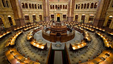 Researchers' desks in the main reading room in the Library of Congress' Thomas Jefferson Building.