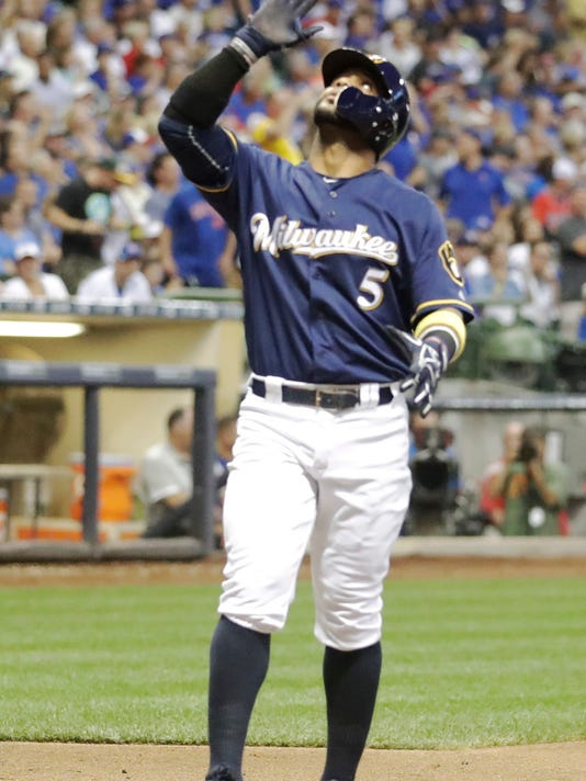 Milwaukee Brewers' Jonathan Villar reacts at home after hitting a home run during the fourth inning of a baseball game against the Chicago Cubs Wednesday, Sept. 7, 2016, in Milwaukee. (AP Photo/Morry Gash)