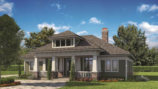 Showing the home's Prairie style, the exterior displays a sleek hipped roof and a wide porch.