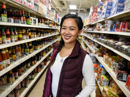 Linh Ngyuen stands in one of the aisles at Viet Tien