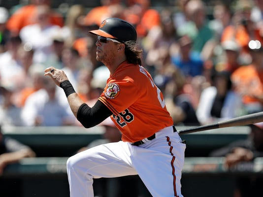 Baltimore Orioles' Colby Rasmus hits a double off Tampa Bay Rays starting pitcher Ryan Weber during the second inning of a spring training baseball game, Friday, March 23, 2018, in Sarasota, Fla. (AP Photo/Chris O'Meara)