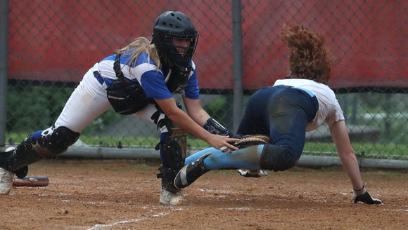 Westlake's Kristin Pierce is tagged out by Rondout