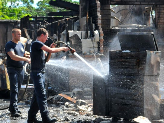 Brevard County Fire Rescue firefighters mop up smoking