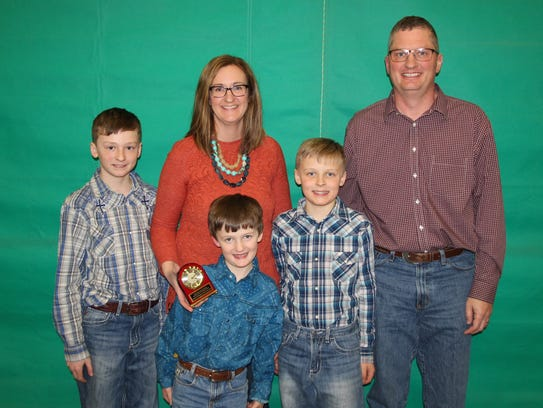 Receiving the Friend of the Wisconsin Sheep Breeders Co-op Award were Bernie O'Rourke and her husband Ron Patterson, who are joined by their children.