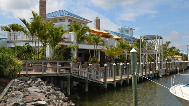 Sunset Grill's deck lined with palm trees. Trala said this year's shipment of trees will be here within the next few weeks.
