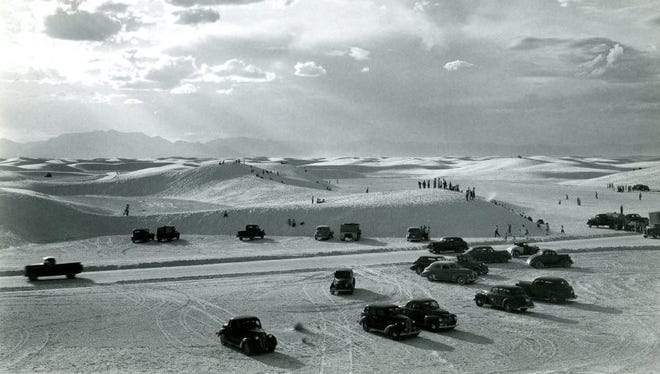 Visitors to the White Sands National Monument enjoy the vast dunes during a Play Day on April 14, 1946.