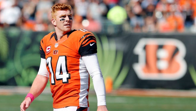 Cincinnati Bengals quarterback Andy Dalton (14) walks off the field during a time out in the game against the Kansas City Chiefs in the second half at Paul Brown Stadium.