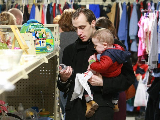 Thursday January 16th, 2014, Jeffrey Nehring and his son Eli shop for clothing an house hold goods at In His Name Clothing Ministry. Mount Pleasant Christian Church's new Community Ministry Center will combine the Living Bread Food Ministry, and In His Name Clothing Ministry/ household goods, in one location. Currently the  Food Ministry operates out of a building at 7555 N. Bluff Road.