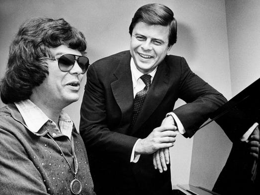James Sasser, right, state Democratic Party chairman, listens to Ronnie Milsap on July 25, 1975, in preparation for the national party's 22-hour telethon beginning the next night.