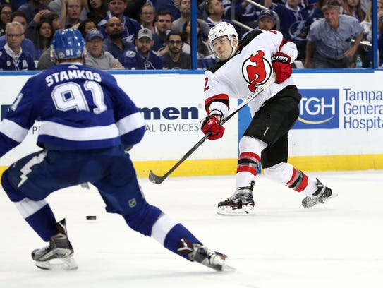 New Jersey Devils defenseman Ben Lovejoy (12) photos