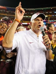 Justin Fuente speaks to the crowd after Virginia Tech