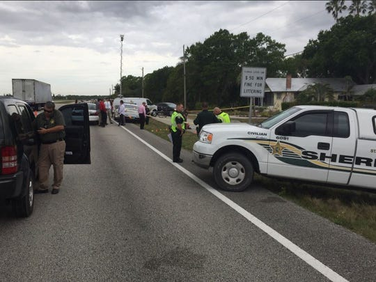 Traffic on westbound Okeechobee Road is restricted to one lane in the area on Tuesday, Feb. 21, 2017, as the St. Lucie County Sheriff's Office investigates the scene where a body was found.