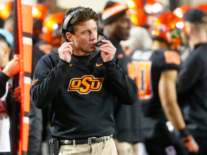 Oklahoma State head coach Mike Gundy walks on the sidelines