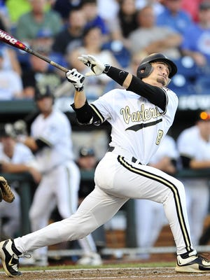 Rhett Wiseman watches his 2-run home run against TCU during the fourth inning in the College World Series at TD Ameritrade Park, Friday, June 19, 2015, in Omaha, Neb.