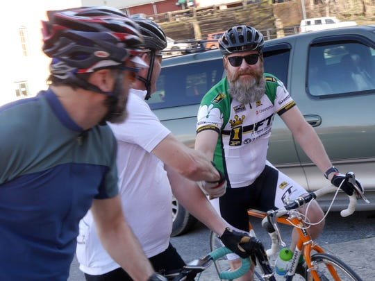 Mark Russell greets other riders behind Black Dog Bikes where the weekly Tuesday night ride from leaves for about a 25 mile loop out of Staunton Tuesday, March 15, 2016