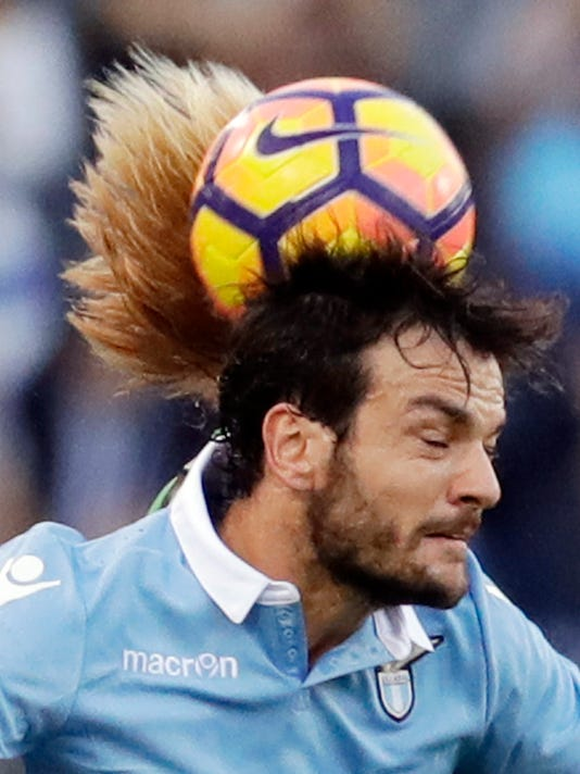 Lazio's Marco Parolo, front, and Sassuolo's Davide Biondini jump for the ball during a Serie A soccer match between Lazio and Sassuolo, at Rome's Olympic Stadium, Sunday, Oct. 30, 2016. (AP Photo/Andrew Medichini)