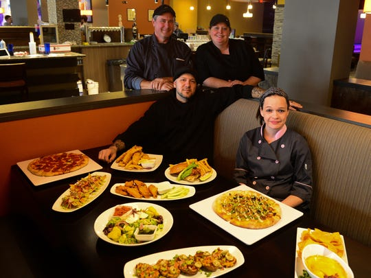 Members of the Lefty's Alley and Eats staff in December with some of the bowling alley's menu items.
