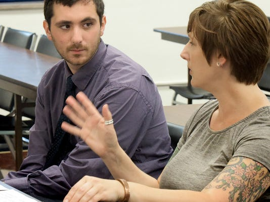 """York County Domestic Violence Fatality Review Team members Nick Silveri-Hiller and Michelle Cooper talk before the team's quarterly meeting at the York County Annex Building Thursday, July 30, 2015. Both are with ACCESS-York, a YWCA York program to eliminate domestic violence. Bill Kalina - bkalina@yorkdispatch.com"""