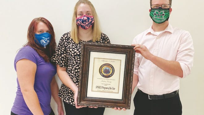 The West Virginia Office of Adult Education presented the Jackson County SPOKES program with the Program of the Year Award. Pictured from left to right are SPOKES program assistant Savanna Whited, SPOKES instructor Emily Lilly, and Career Development Consultant Todd Murray.