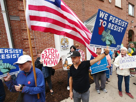 Adam Bell, c, of Verona joined Immigrant rights organizations protesting in front of the Congressional district office of Rodney Frelinghuysen demanding to speak with him as well as legislation that provides a path to citizenship showing in force they will not let DACA go without a fight