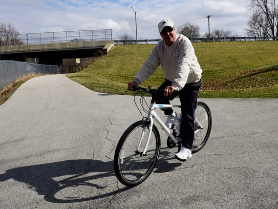 Stephen Holman of Fremont rides his bike on the trail