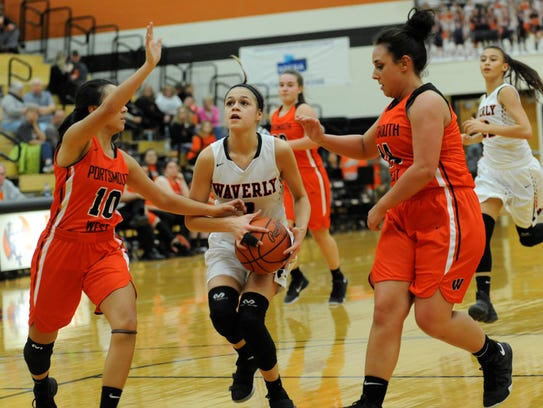 Waverly's Carli Knight splits two Portsmouth West defenders