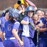 Male Bulldogs' Madison Mudd' is greeted by her teammates after homering in the top of the 2nd inning. 29 May 2015