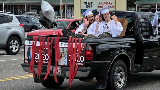 Soon-to-be graduates of Wells High School parade down Post Road in Wells, Maine, on Sunday, June 7, 2020, as part of the school's modified end-of-year festivities amid the COVID-19 pandemic.