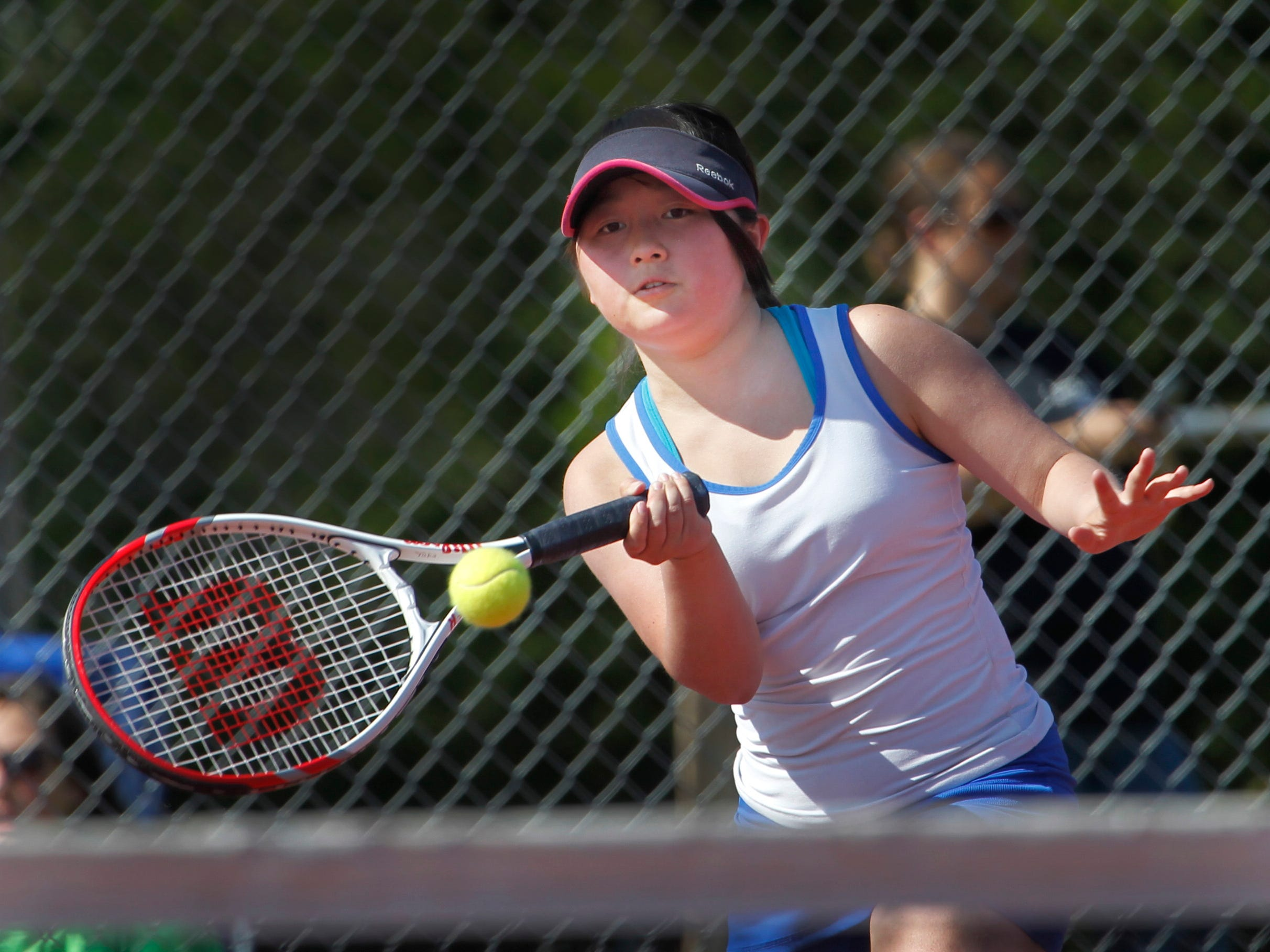 Montgomery Central's Yuka Fujiwara returns a shot against Summertown during region tournament action at Montgomery Central on Thursday. Fujiwara won her match in three sets. To see a gallery of photos go to www.theleafchronicle.com.