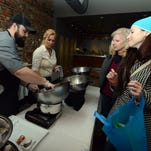 Jessie Pingle, right, smiles as she and her sister Dana Hoff, both from Lancaster, watch as Cody Hunt, left, and Kim Sauer, second from left, make a chocolate covered pretzel and jalapen–o for them Friday, April 8, 2016, at Ale House 1890 in Lancaster. Pingle and Hoff were taking part in Destination Downtown Lancaster's annual Chocolate Walk. People traveled amongst more than 40 businesses that took part in the event tasting different chocolate confections.