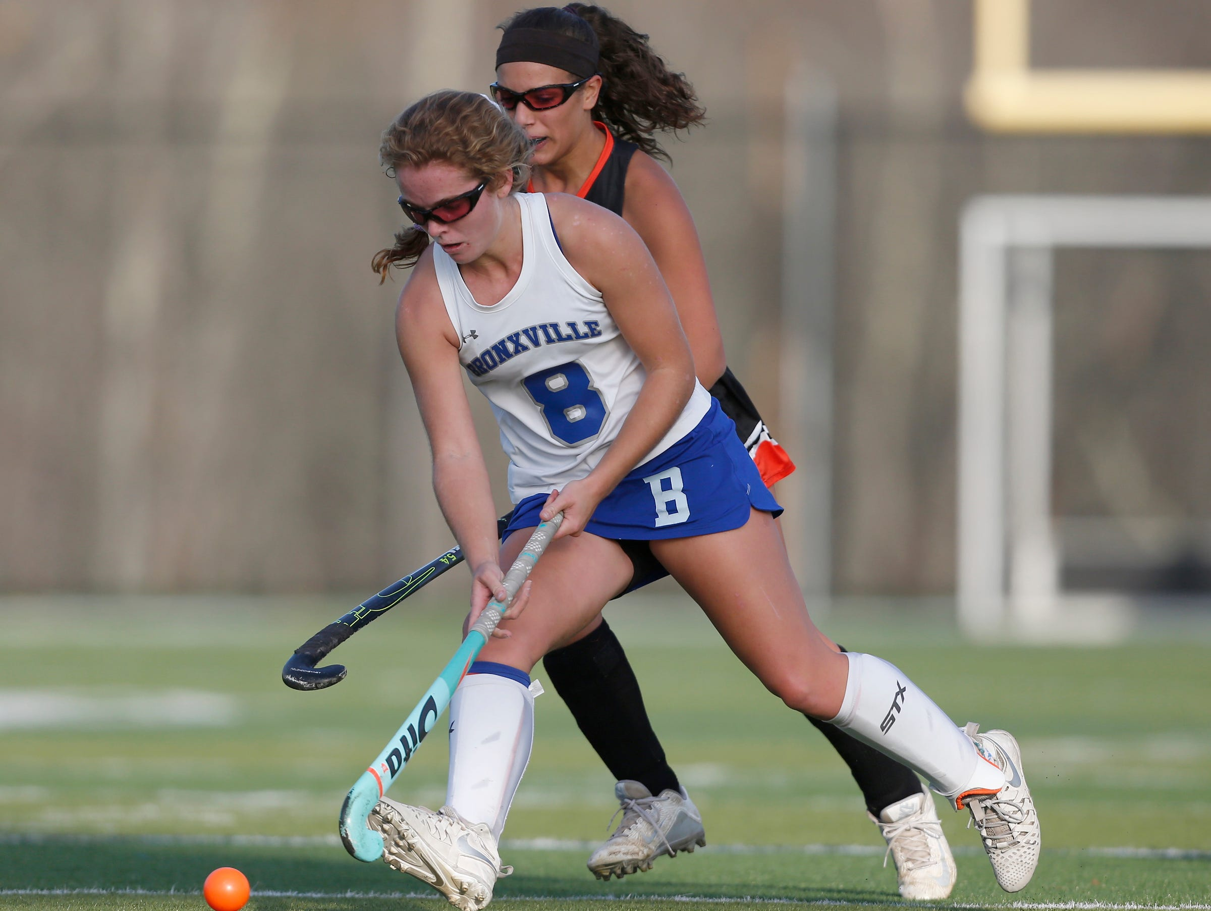 Bronxville's Ellie Walsh (8) works the ball during their 7-1 win over Croton in the Class C field hockey sectiion finals at Brewster High School on Tuesday, November 1, 2016.